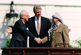 Israeli Prime Minister Yitzhak Rabin, U.S. President Bill Clinton, and Yasser Arafat at the Oslo Accords signing ceremony on 13 September 1993