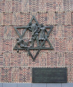 """Davidster"" (Star of David) by Dick Stins is a Holocaust memorial in The Hague. The text at the side (in Dutch and Hebrew) is from Deuteronomy 25:17, 19 – ""Remember what Amalek has done to you ... do not forget."""