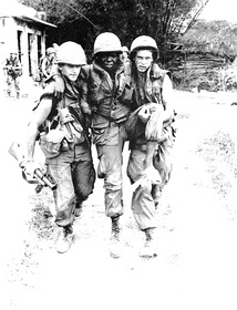 A wounded African American soldier being carried away, 1968