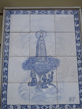 Many houses and apartments in The Ironbound neighborhood of Newark, New Jersey are embellished with elaborate azulejos.  One common image is Our Lady of Fatima, seen here.