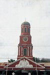 Clock tower of red bricks.