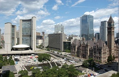 Toronto City Hall (left) next to Old City Hall (right). The latter building was used from 1899 to 1965, whereas the former has been used since 1965.