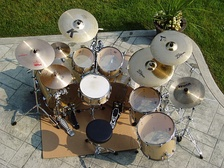 A seven-piece kit with snare, double bass drums, two hanging toms, two floor toms, hi-hats, ride cymbal, three crash cymbals, splash cymbal and china type