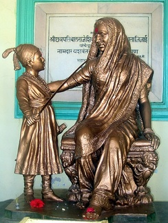 A statue of young Shivaji with Jijabai installed at the fort of Shivneri in 1960s