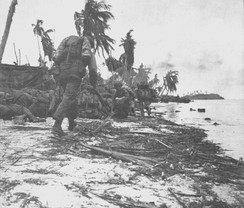 U.S. Marines move inland.