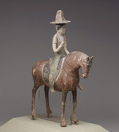 Tang dynasty figurine of a woman riding a horse