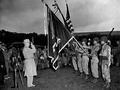 President Truman salutes the colors of the combined 100th Battalion, 442nd Infantry, during the presentation of the seventh Presidential Unit Citation.