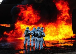 Firefighters wearing PPE tackle an aircraft fire during a drill at Dyess Air Force Base in Abilene, Texas