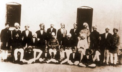 In this historical photograph of students and staff of National College, Lahore, Singh can be seen standing fourth from the right.