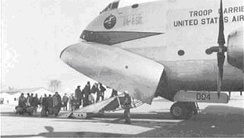 French military personnel board a Douglas C-124C Globemaster II (53-004) at Orly Field, Paris, bound for Indochina, May 3, 1954