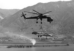 A CH-54 Tarhe lifting an F-100A to Hill Air Force Base, Utah for static display, 1979