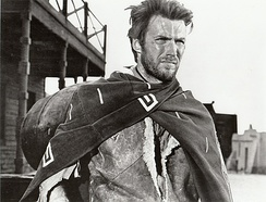"Clint Eastwood as the ambiguously-named protagonist of the Dollars Trilogy (marketed as ""the Man with No Name"") in a publicity image of A Fistful of Dollars, a film by Sergio Leone."
