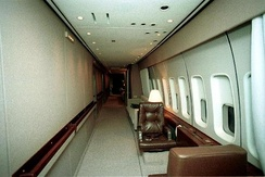 The aircraft's port-side (left) corridor. The two chairs are typically occupied by Secret Service agents.