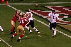 Cutler passes in a game against the San Francisco 49ers