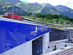 Entrance of the new Lötschberg Base Tunnel, the third-longest railway tunnel in the world, under the old Lötschberg railway line. It was the first completed tunnel of the greater project NRLA.