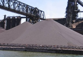 This stockpile of iron ore pellets will be used in steel production