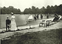 Children sailing their boats on the Round Pond at Kensington Gardens in 1896