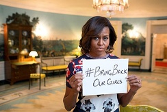 "Obama holding a sign with the hashtag ""#bringbackourgirls"" in May 2014."