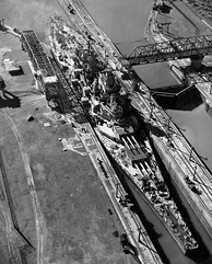"The USS Missouri, an  Iowa-class battleship, passes through the canal in 1945. The 108' 2"" (32.96 m) beams of the Iowas and preceding  South Dakota class were the largest ever to transit the Canal."
