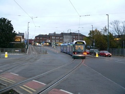 Nottingham Express Transit in the United Kingdom uses a 750 V DC overhead, in common with most modern tram systems.