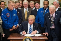 President Trump signs an executive order re-establishing the National Space Council, with astronauts Dave Wolf and Al Drew, and Apollo 11 astronaut Buzz Aldrin (left-to-right) looking on.