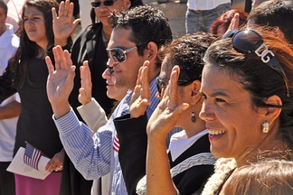 Immigrants to the United States take the Oath of Allegiance at a naturalization ceremony at the Grand Canyon National Park in Arizona, September 2010.
