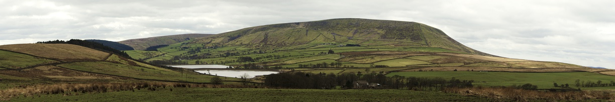 A panoramic image of Pendle Hill in 2012 showing the northeast slopes, known as the Big End, overlooking Black Moss Reservoirs on the edge of Barley-with-Wheatley Booth. The footpath from Barley (not pictured) to the summit can be seen ascending from left to right. (The full-size image is 10 times larger.)