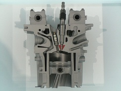 A cutaway model of a petrol direct injected engine