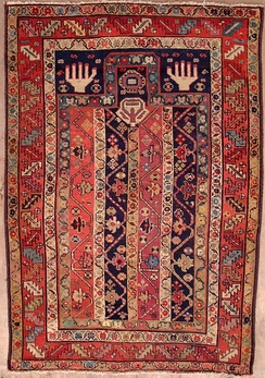 Shirvan Prayer rug with a rectangular niche, depicting inwoven hands and an ornament representing the mosque lamp