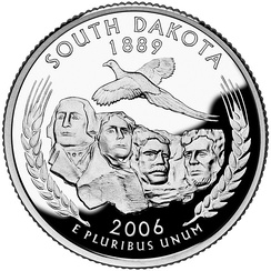 Reverse side of U.S. quarter coin with a commemorative South Dakota design depicting Mt. Rushmore, a pheasant, wheat, and the year of statehood