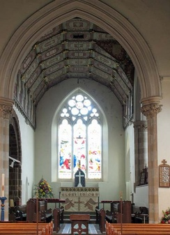 A medium-sized English church showing the nave, chancel arch, and a chancel with choir and sanctuary