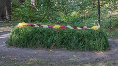 Tolstoy's grave with flowers at Yasnaya Polyana