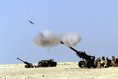 A 155 mm artillery shell fired by a United States 11th Marine Regiment M-198 howitzer