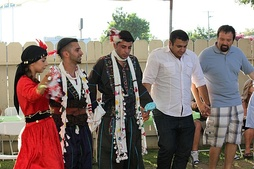 Traditional clothing may be worn for Assyrian folk dance.