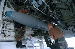 A 2,000 lb (910 kg) BDU-56 bomb being loaded onto a bomb bay's rotary launcher, 2004
