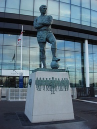 Statue of Bobby Moore, England's 1966 FIFA World Cup winning captain, stands outside the stadium entrance looking down Wembley Way