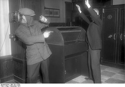 A masked robber threatens a person with a gun in Germany, December 1931.