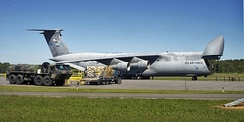137th AS C-5A Galaxy (s/n 70-0460) sits on the flightline before cargo is loaded on 5 September 2005 by Airmen with the 109th Aerial Port Squadron at the Albany International Airport. The cargo was bound for Gulfport, Mississippi, in support of Hurricane Katrina relief operations.