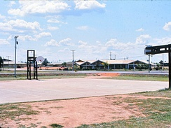 Basketball court and a mess hall, looking northeast at Benning Ave and Bataan Drive, 1970