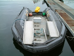 An inflatable boat capable of carrying a car.