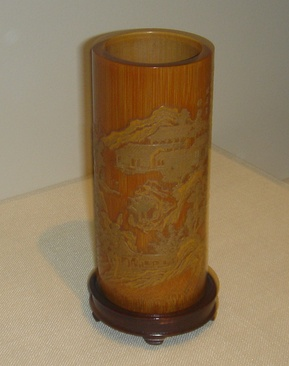 A bamboo brush holder or holder of poems on scrolls, created by Zhang Xihuang in the 17th century, late Ming or early Qing Dynasty. In fanciful Chinese calligraphy in Zhang's style, the poem Returning to My Farm in the Field by the 4th century poet Tao Yuanming is incised on this cylindrical bamboo holder.