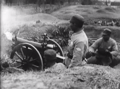 NRA troops firing artillery at Communist forces