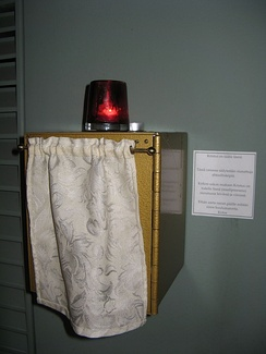 A tabernacle at Mikael Agricola Lutheran Church in Helsinki, juxtaposed with a chancel lamp and note about the real presence.
