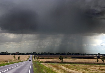 Late-summer rainstorm in Denmark. Nearly black color of base indicates main cloud in foreground probably cumulonimbus.