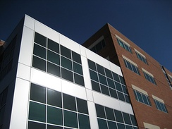 Tuality Healthcare's office building is a five-story red brick structure with silver colored metal and glass accents.