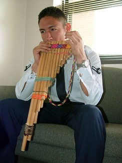 Playing the zampoña, a Pre-Inca instrument and type of pan flute.