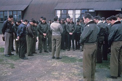 Captain Wilbur C. Ziegler, station Chaplain, leads pilots of the 359th Fighter Group in prayer at East Wretham.