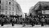 A barricade in the Paris Commune, 18 March 1871. Around 30,000 Parisians were killed, and thousands more were later executed.