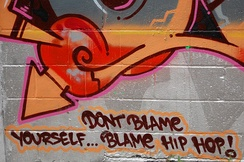 "A graffiti artist uses his artwork to make a satirical social statement on censorship: ""Don't blame yourself ... blame hip hop!"""