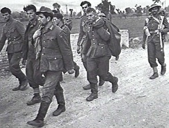 German prisoners being escorted by Indian troops after the Battle of the Sangro, Italy, December 1943.